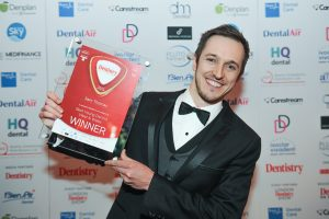 Best young dentist image receiving award